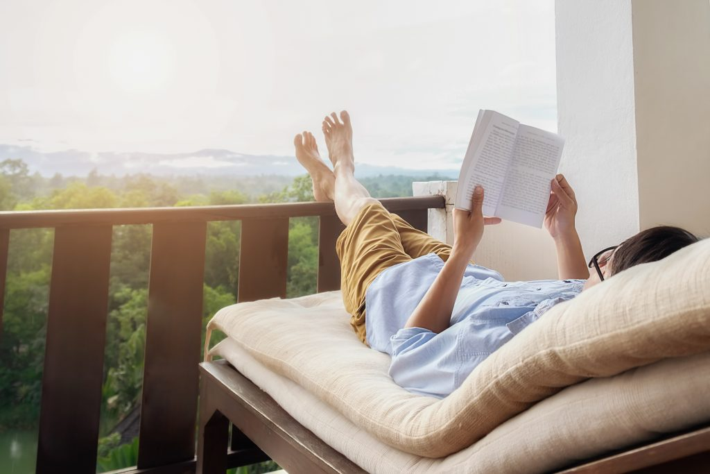 Person relaxing and reading