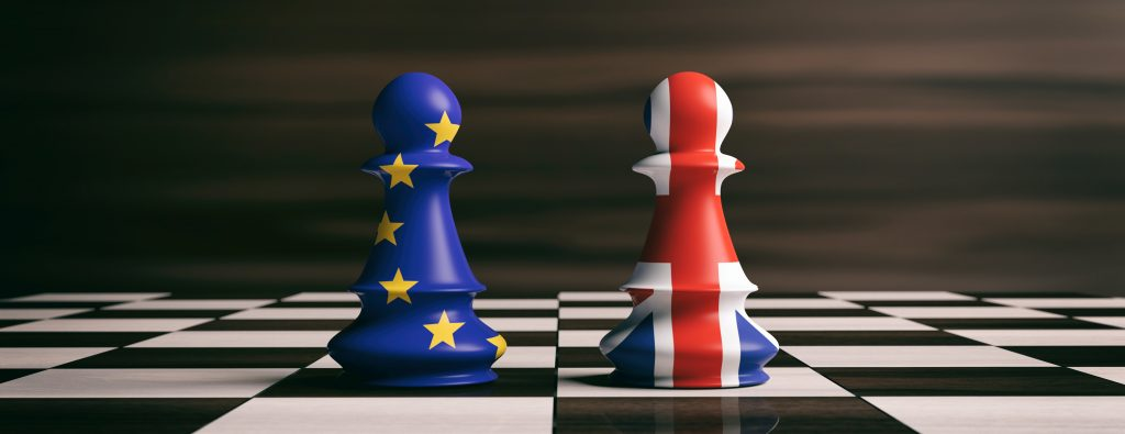 Brexit United Kingdom and European Union flags pawns on chessboard